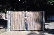 Pleasant Grove - Rodeo Grounds Dumpster Enclosure - 6' High Double Gate with Tan Tube Slats & Fulcrum Latch